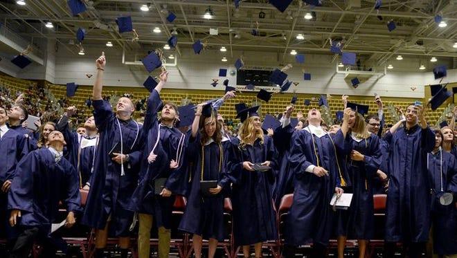 Roberson High graduates celebrate Saturday.