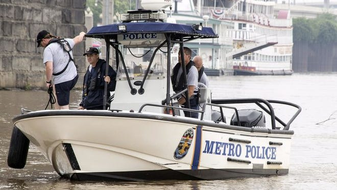 Due to swift currents and high water in the Ohio River, LMPD was unable to employ divers in a search for missing persons from a capsized pontoon on Sunday morning