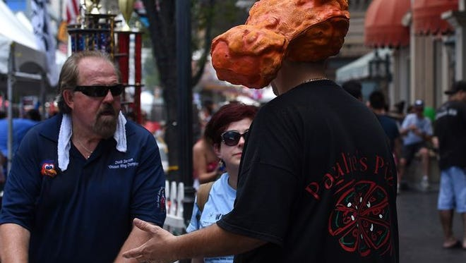 "Paulie's Pizza was one of the winners of the Fourth Annual Biggest Little City Wing Fest held in downtown Reno, getting first place for ""People's Choice Wing."""