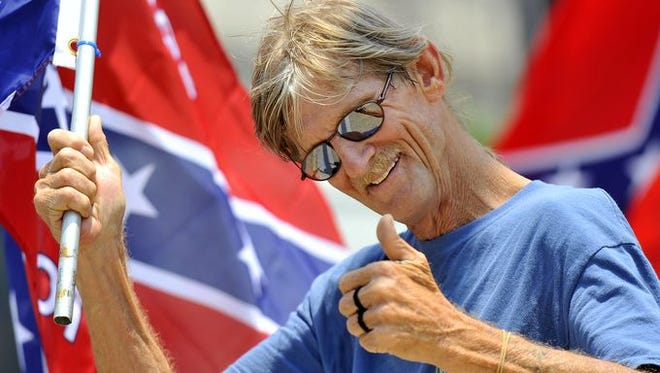 Protesters in favor of keeping the Confederate flag demonstrate in Columbia.
