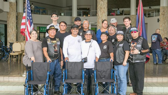 Members of the Legends Motorcycle Club recently donated 15 wheelchairs to people with disabilities who could not afford them.