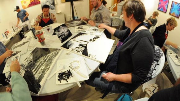 Art enthusiasts attend a Geeks Night Out event at the