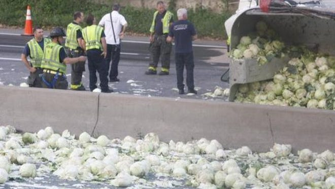 Photo from the scene of the cabbage truck crash on I-490 Monday.