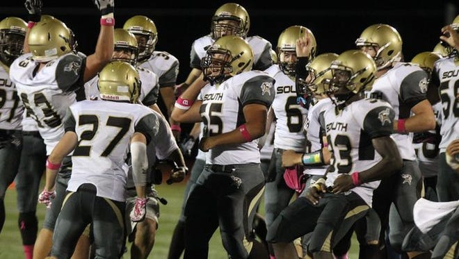 Clarkstown South celebrates its 17-14 victory over rival Clarkstown North on Oct. 2, 2014.