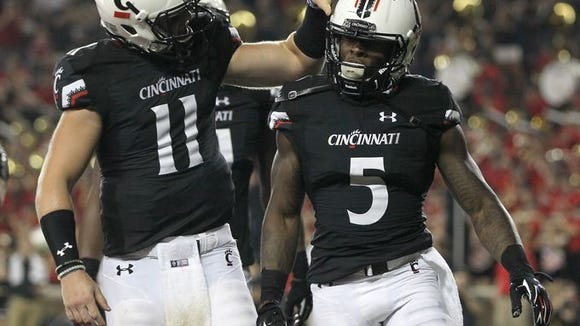 UC quarterback Gunner Kiel (11) and running back Mike Boone (5) did plenty of celebrating against Alabama A&M. Another massive crowd is expected at Nippert Stadium this week.