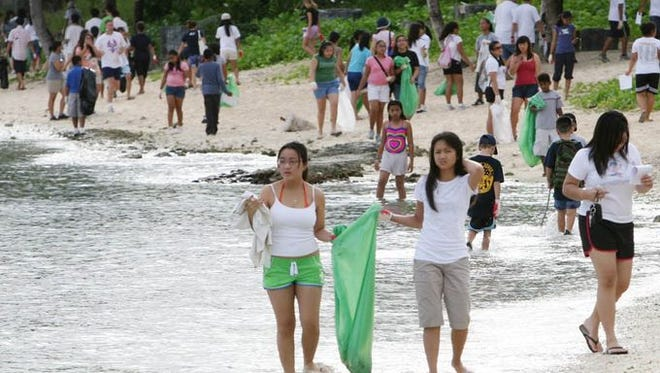 In this file photo, Guam residents participate in the annual International Coastal Cleanup.