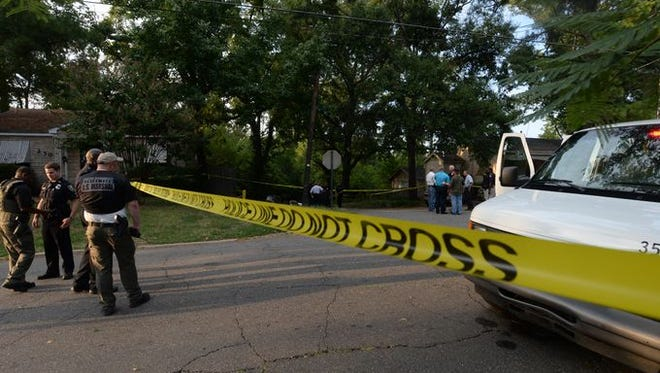 Police work the scene after Mohamed Ibrahim was killed in an officer-involved shooting on Sept. 6.