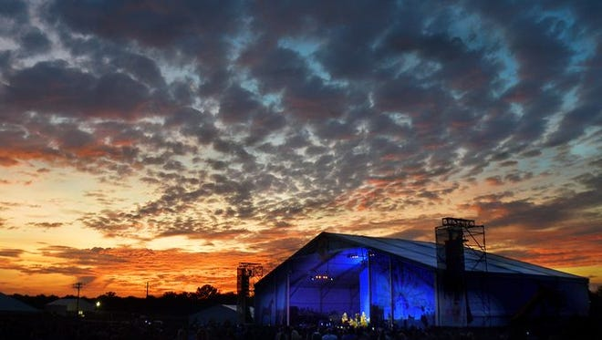 The sunset brings down the curtain on the last concert at the Midnight Sun stage during the Pilgrimage Music and Cultural Festival in Franklin on Sunday.