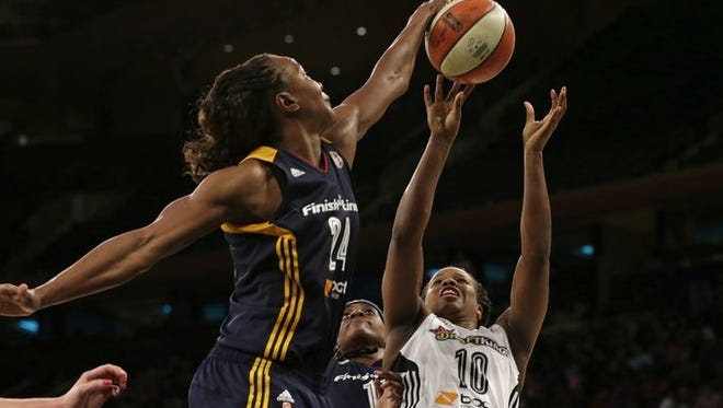 Indiana Fever forward Tamika Catchings blocks a shot during the second half in Game 3 of the WNBA basketball Eastern Conference finals at Madison Square Garden Tuesday.