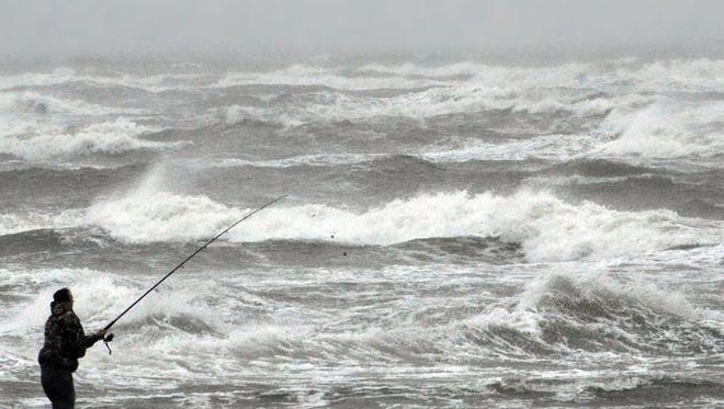 Luke Seymour of Canton, St. Lawrence County, braves 30-knot winds and heavy surf to fish off the 2nd Avenue Beach in North Wildwood, N.J.