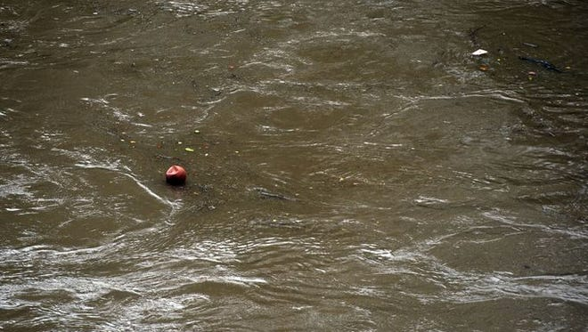 The French Broad River seen after heavy rains Saturday in Asheville.