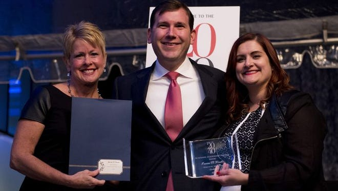 Jason el-Koubi is honored at the 2014 20 Under 40 Awards. Presenting the awards were Judi Terzotis, president and publisher of The Daily Advertiser, and Anne Falgout, president of The 705-Young Leaders of Acadiana.