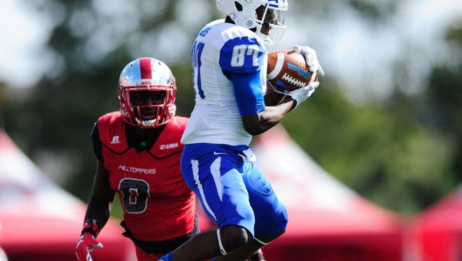 MTSU wide receiver Richie James makes a catch during last Saturday's blowout loss at Western Kentucky.