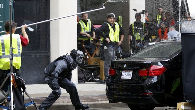 The crew of Marauders films a scene in front of Stock Yard Bank & Trust Saturday, Sept. 26, 2015. Bruce Willis and Chris Meloni star in the movie that will premiere in 2016.