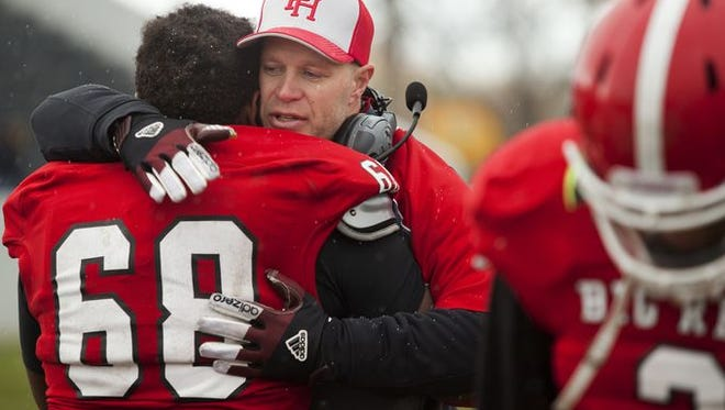Port Huron coach Ryan Mullins gives senior Larenz Brown a hug and congratulates him on a good season after losing to East English Village in a Division 2 pre-district game Saturday, Nov. 1, 2014 at Memorial Stadium. Port Huron lost 40-21, finishing the season 7-3.