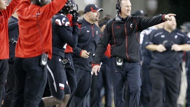 Tommy Tuberville gestures during UC's upset of the Miami Hurricanes Oct. 1, when the Bearcats drew a Nippert Stadium record crowd.
