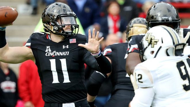 UC quarterback Gunner Kiel looks to pass during the Bearcats' 52-7 win against UCF.