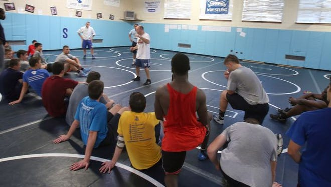 Suffern wrestling coach Chris Matteotti during a practice at the school Nov. 12, 2014.