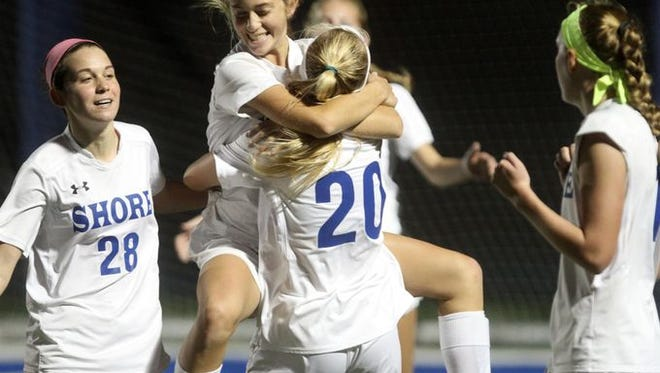 Shore Regional's Frankie McDonough leaps into the arms of teammate Sophie Hauritz after scoring a second half goal against Metuchen in the Central Group I girls soccer sectional final, Thursday, November 12, 2015, in West Long Branch.  Jason Towlen/Staff Photographer