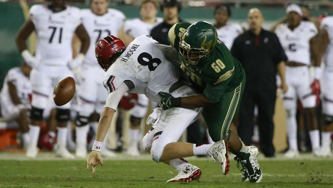 UC quarterback Hayden Moore is sacked and fumbles during Friday's 65-27 loss at USF. Moore had replaced starter Gunner Kiel, who was pulled after throwing two interceptions.