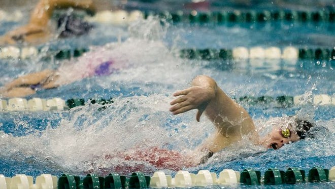St. Clair swimmer Alexis Smith competes in the 400 Yard Freestyle Relay at the state swim meet at Eastern Michigan University in Ypsilanti, Mich. on Saturday, Nov. 21, 2015.
