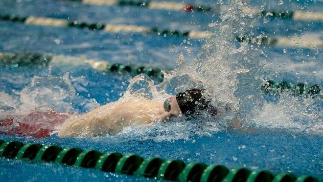 St. Clair swimmer Alexis Smith competes in the 100 Yard Freestyle at the state swim meet at Eastern Michigan University in Ypsilanti, Mich. on Saturday, Nov. 21, 2015.