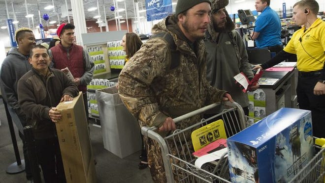 Customers purchase electronics at Best Buy during a Black Friday promotion Thursday, November 26, 2015. Some stores around Fort Collins opened the evening of Thanksgiving Day.