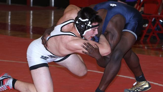 Suffern, North Rockland, John Jay East Fishkill and John Jay Cross River wrestled in the Section 1 Dual Meet Championships final four at North Rockland Dec. 11, 2014. Suffern beat John Jay Cross River 43-28 in the final.
