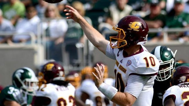 Lansing Catholic grad Cooper Rush has thrown for a CMU single-season record 3,703 yards this fall.