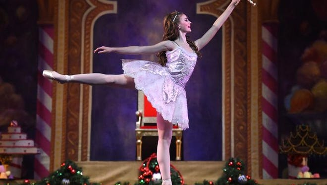 """A ballerina dances in a 2014 production of """"The Nutcracker,"""" which will be showing at the Pioneer Center this month."""