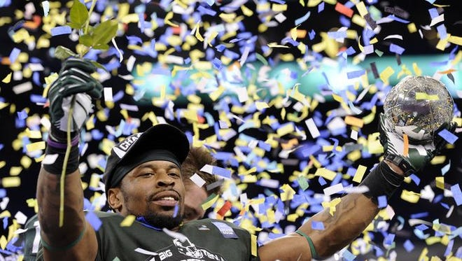 Michigan State celebrated its victory in the Big Ten football championship game in 2013 at Lucas Oil Stadium.