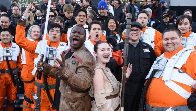 "Fans dress as characters from ""The Force Awakens"" in anticipation for the new film."