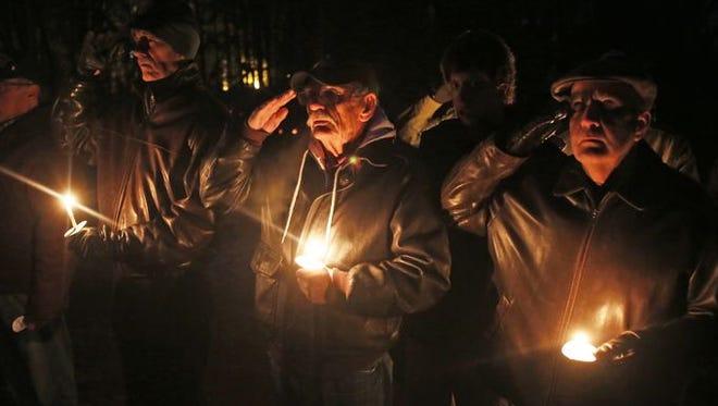 Vietnam veterans participate in 2014 vigil at Lasdon Park.