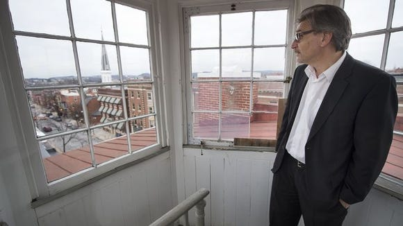 Dominic DelliCarpini is dean of community engagement for York College. He'll head the conversion of the former Lafayette Club into a center for community engagement. Here, he stands in the cupola at the former club building in York.