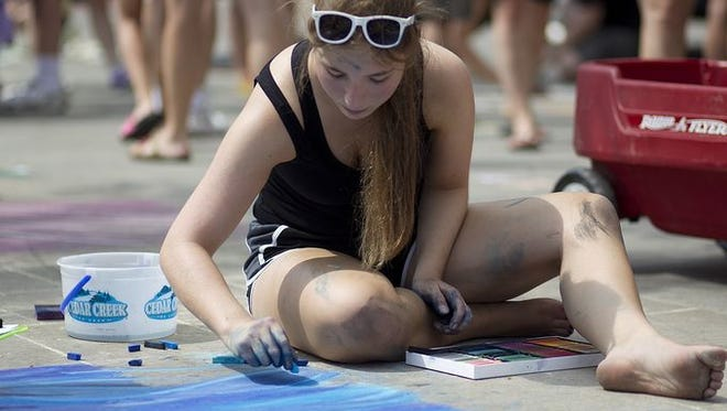 Chalk artists take to the 400 Block for Chalkfest in downtown Wausau, Saturday, July 11, 2015.