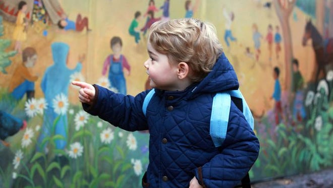 Prince George examines the mural on the wall of his nursery school on his first day, in photo taken by his mum, Duchess Kate of Cambridge, on Jan. 6, 2015.