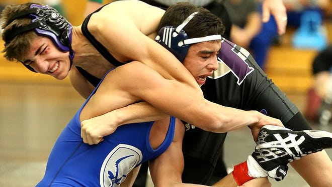 Poudre's Zachary Leal, bottom, wrestles Fort Collins' Cam Turman in the 126-pound weight class during the Arnold Torgerson Invitational wrestling tournament at Fort Collins High School on Saturday, Jan. 9, 2016.