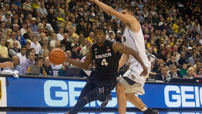 """Xavier freshman Edmond Sumner, shown here driving against Wake Forest, said he feels much better since suffering a concussion Dec. 31 at Villanova. Said Sumner: """"I've been falling since I've been playing basketball. I'm used to it."""""""