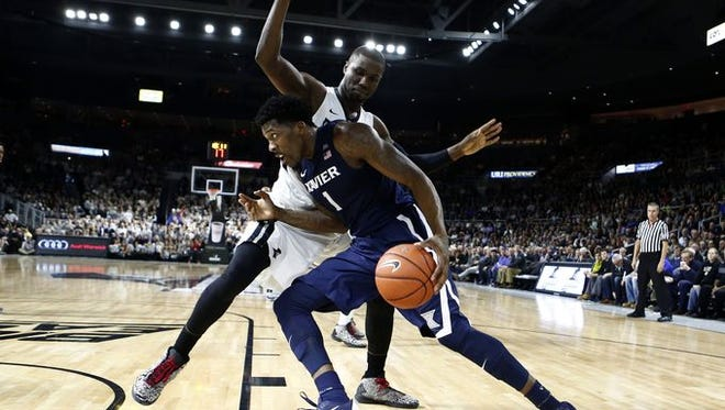 Xavier junior Jalen Reynolds, guarded by Providence's Ben Bentil, notched his third double-double this season (15 points, 11 rebounds) in Tuesday's 75-68 victory over the Friars at the Dunkin' Donuts Center.