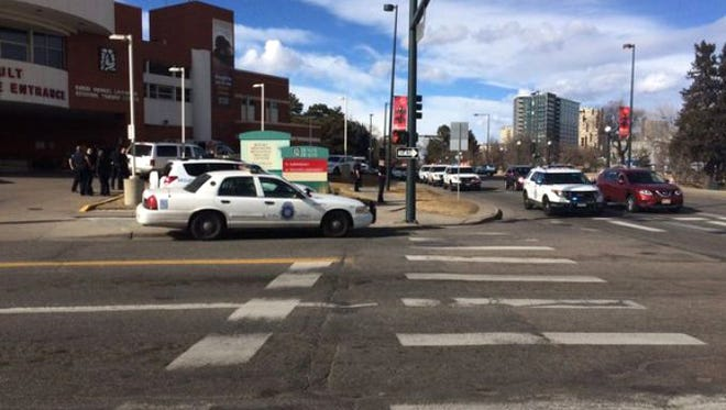 In this photo provided by 9NEWS, authorities respond to the scene of a deadly shooting and stabbing at the National Western Complex, Saturday, Jan. 30, 2016, in Denver. Denver police say multiple people were injured at The Colorado Motorcycle Expo.