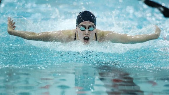 West York's Maelyn Elder swims to victory in the 100 butterfly at York Suburban. She has her name on the top swimmers list.