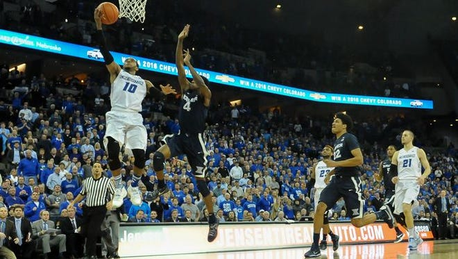 Maurice Watson Jr. (left) scored 32 points Tuesday for Creighton and proved difficult to keep out of the lane. The Bluejays defeated No. 5 Xavier 70-56.