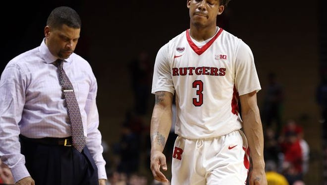 Rutgers coach Eddie Jordan and point guard Corey Sanders leave the court after a recent loss.