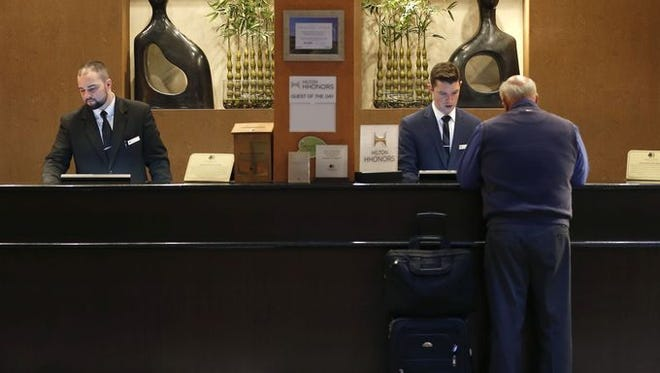 A guest checks into the DoubleTree by Hilton Hotel Springfield in November.