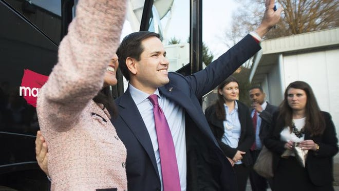 Republican presidential candidate Marco Rubio and Governor Nikki Haley wave from outside the campaign bus after stopping at the Beacon Drive-In in Spartanburg on Thursday, February 18, 2016