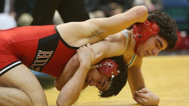 Fox Lane's Matt Grippi and Hilton's Yianni Diakomihalis wrestle in the 138-pound weight class in the finals of the New York State wrestling championship at the Times Union Center in Albany Feb. 27, 2016. Diakomihalis won the match.