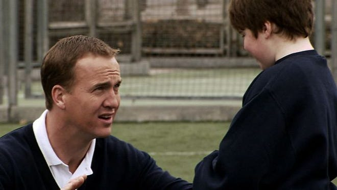 Peyton Manning in his United Way commercial parody on Saturday Night Live.