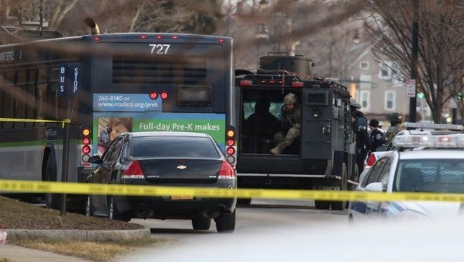 A 49-year-old man was shot dead by a SWAT sniper after he pointed a shotgun at police officers early Monday, March 7, 2016, according to Rochester police.