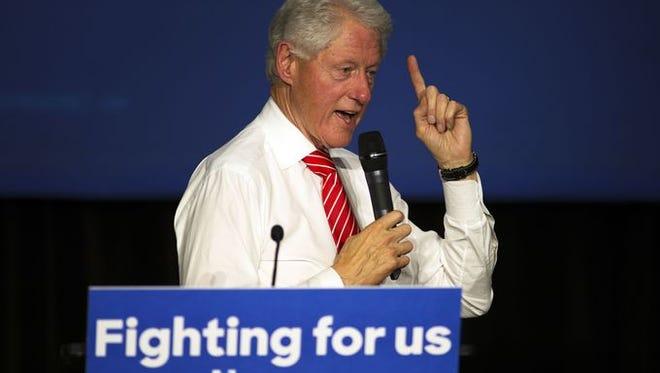 Former President Bill Clinton speaks at Asheville High School Sunday night.