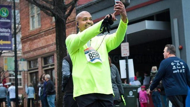 Tarell Rodgers pauses to take a selfie during 2016 The Greenville News Downtown Run. He plans to run in the 100-Mile Without Limits Running Series benefiting Trees Greenville in May.